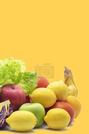 Photo for Fresh organic fruits and vegetables on a yellow background - Royalty Free Image