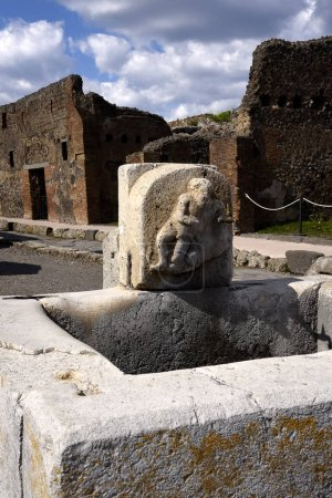 Water spout in the street of the once buried Roman...
