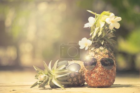 Trendy pineapples wearing hipster sunglasses