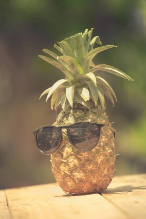 Trendy pineapple wearing hipster sunglasses