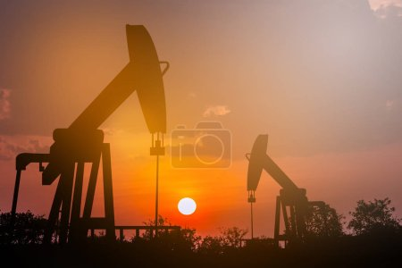oil rig energy industrial machines for petroleum at sunset