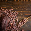 Cocoa beans and cocoa pod on old natural wooden ba...