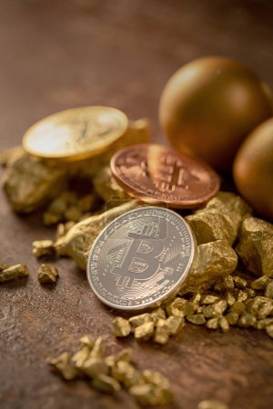 Photo for Gold bitcoins and Gold nugget grains on wooden surface - Royalty Free Image