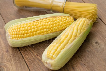 sweet corn on cobs kernels on wooden background