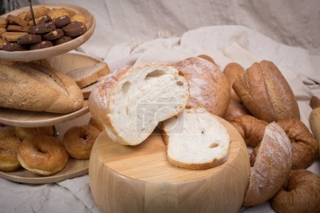 Fresh homemade bread in a cotton cloth background