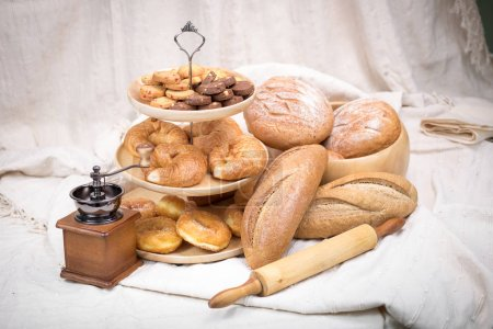 Fresh homemade bread in cotton cloth background