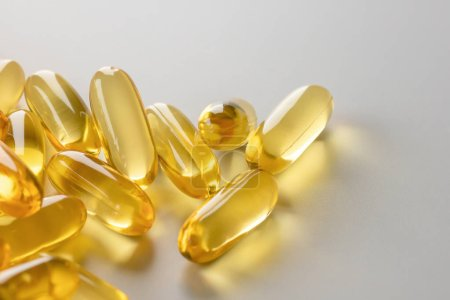Photo for Vitamins supplements pills omega 3 gold fish oil capsules - Royalty Free Image