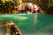 Blue stream waterfall in natural rainforest jungle, natural landscape background