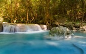 Blue stream waterfall in deep tropical forest national park of Thailand