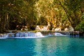 Blue stream deep forest waterfall in tropical natural landscape background