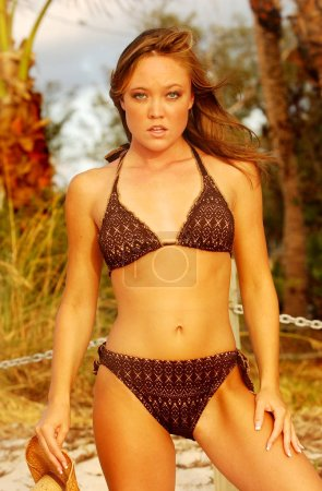 Photo for Brown croquet tight weaved bikini  - impressive abs on young fresh model with no makeup - nature look of a real beauty - Sunshine sun tan sun drenched sunny healthy attitude of a carefree babe - Royalty Free Image