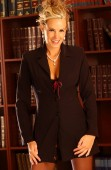 Conservative Traditional Sharp Business Suit with Stockings - Job Interview Corporate Ladder Outfit - Tear drop pearl necklace and earrings - Dark Copy Space - Adorable Face - Legal Law Book Library  Indoor studio - tantalizing exciting appealing