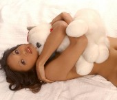 I love you valentine cute white teddy bear bare with little red bow - Natural Beauty model playfully poses topless and nude - dark short curly hair small breasts and nipples exposed black or white  background - simple clean makeup