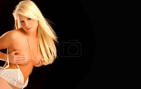 Photo pour Playboy model Deana Durbin implied topless poses on black background for wallpaper isolated - image libre de droit