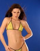 Professional swimsuit model posing in skimpy swimwear