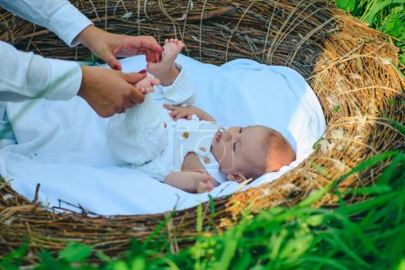 Pediatrist doctor make massage to newborn baby. Newborn healthy care. Pediatrist and newborn patient. Newborn baby body massage. Quality pediatric care