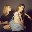 Two young pretty sexy girls in stylish clothes pos...