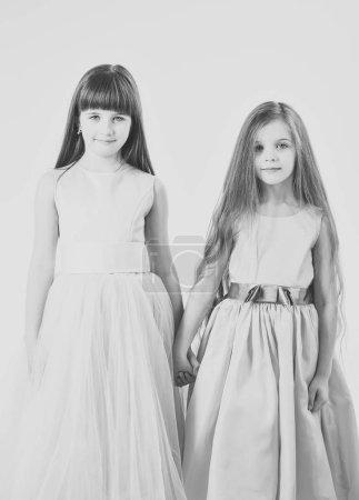 Funny family. Two cute little children girls. Sist...