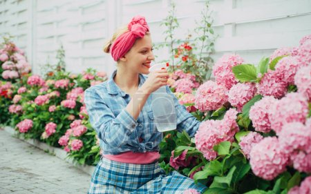 Flower care and watering. soils and fertilizers. hydrangea. Spring and summer. happy woman gardener with flowers. woman care of flowers in garden. Greenhouse flowers. Gardening is my passion