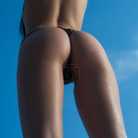 Photo for Female ass or womans buttocks in black bikini panties. - Royalty Free Image