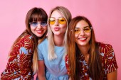 fashion lifestyle portrait of  young hipster girls best friends having fun  on pink background