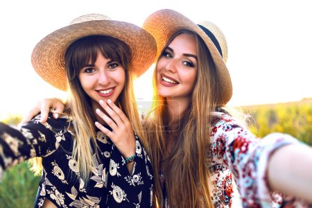 Photo for Young beautiful women relaxed  on tropical island beach taking selfie - Royalty Free Image