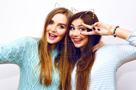 Photo for Close up fashion lifestyle portrait of two young hipster girls best friends taking selfie - Royalty Free Image