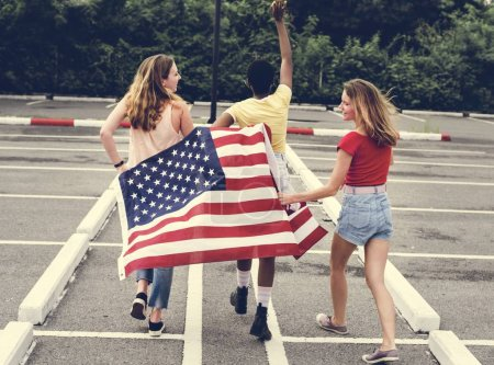 Rear view of diverse women group with American flag
