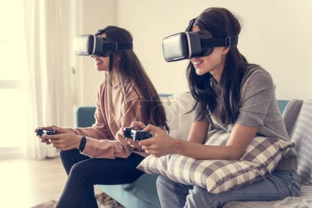 Women experiencing virtual reality with VR headset