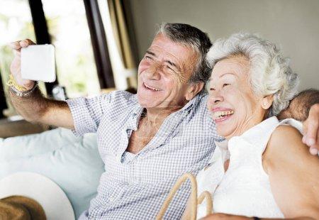 A senior couple taking a selfie