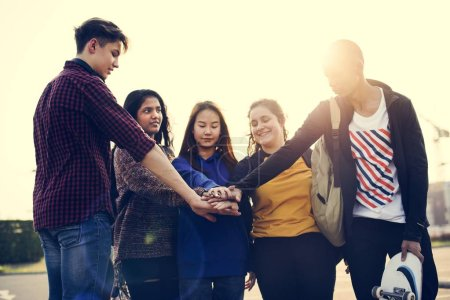 Group of friends hands stacked together support and teamwork concept