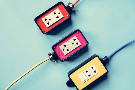 Electrics power supply plugs on blue background