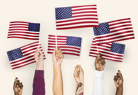 Hands waving flags of the United States