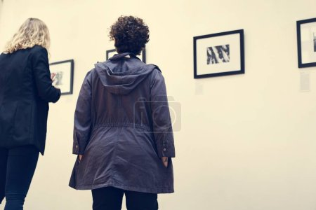 People looking at pictures in exhibition, original photoset
