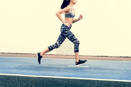 Photo for White woman running on track - Royalty Free Image