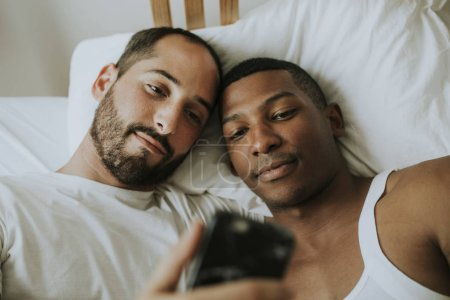 Couple taking a selfie in bed