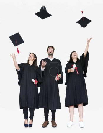 Photo for Group of grads throwing their hats in the air - Royalty Free Image