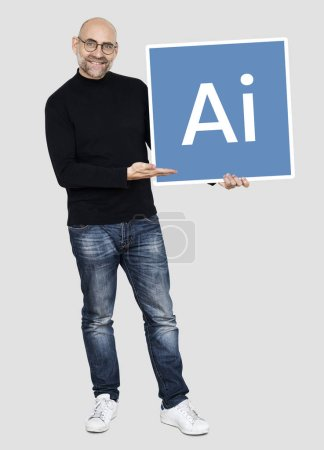 cheerful man holding artificial intelligence icon on grey backdrop