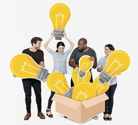 Group of diverse people with bright yellow light bulbs