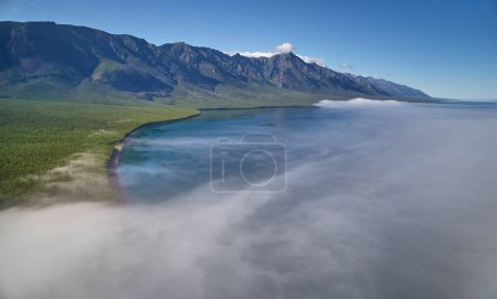 Mountain lake scenery with sun