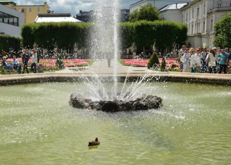 Photo for SALZBURG, AUSTRIA - JULY 25, 2017. Fountain in the famous Mirabell Garden with the old historic Fortress Hohensalzburg in the background in Salzburg, Austria - Royalty Free Image