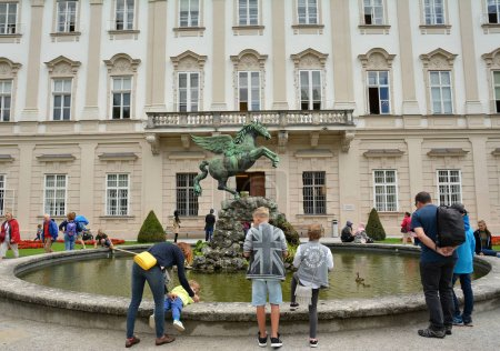 Photo for SALZBURG, AUSTRIA - JULY 25, 2017. Winged horse statue and Mirabell Palace and Gardens in Salzburg, Austria - Royalty Free Image
