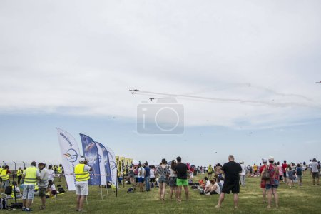 Photo for TUZLA, CONSTANTA, ROMANIA - AUGUST 19, 2017. Airshow Aeromania, amazing aviation show and top summer attraction for crowd of tourists in the south - eastern Romania , on Tuzla Aerodrome. - Royalty Free Image