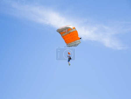 Photo for TUZLA, CONSTANTA, ROMANIA - JULY 2, 2016. Parachute jumping at air show. - Royalty Free Image