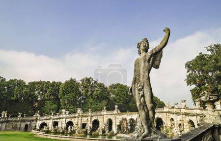 Foto de CASERTA, NAPLES, ITALY - NOVEMBER 11, 2015. Caserta Royal Palace and his gardens - fountain with statues and water reflections. - Imagen libre de derechos