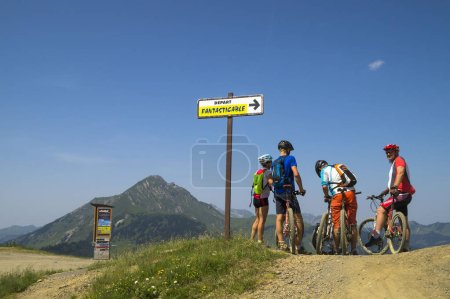 Photo for Cyclists travelling in Alps mountains - Royalty Free Image