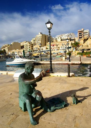 Photo for ISLAND OF MALTA,EUROPE - NOVEMBER 11, 2015. Fisherman and cat statue at Spinola Bay, St Julian's , awesome all seasons destination in Maltese Islands. - Royalty Free Image