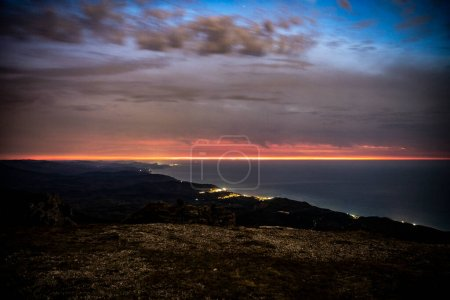 Photo for Sunrise in the mountains by SUV with morning fog from early autumn - Royalty Free Image