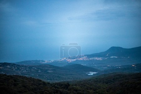 Photo for Mountains at sunset in fog and gray clouds - Royalty Free Image