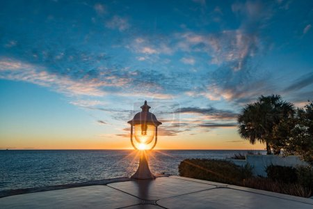 Photo for Sunset on the beach with lighthouse and sea view - Royalty Free Image